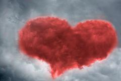 stormy clouds in the shape of heart - stock illustration