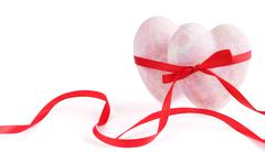Two hearts tied with ribbon - stock photo