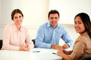 Charming adult colleagues smiling at you Stock Photos