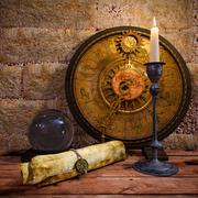 concept still life with zodiac sighs and candle - stock photo