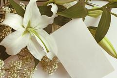 White lily flowers and post card Stock Photos