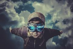 Stock Photo of imagination, boy flying, daydreaming he´s a pilot