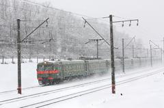 Train on the snowy railway Stock Photos