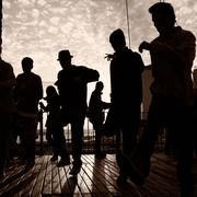 Men dancing on terrace - stock photo