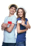 Happy couple showing credit cards Kuvituskuvat