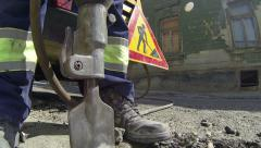 Construction Worker using Jack Hammer Stock Footage