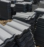 load of roofing tiles at a residential home construction site. - stock photo