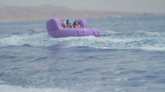 Collection - Group of friends enjoying tubing attraction on the water 1 Stock Footage