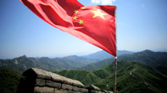 Chinese National Flag Great Wall of China red stars Beijing Stock Footage
