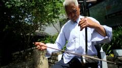 Chinese musician Erhu violin music Great Wall Mutianyu - stock footage