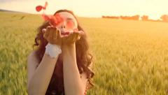 Beautiful Young Woman Blowing Flower Petals Summer Dress Field Stock Footage