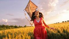 Beautiful Girl Red Summer Dress Running Kite Summer Meadow Stock Footage