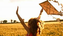Young Woman with Kite at Sunset Free Lifestyle Concept Stock Footage
