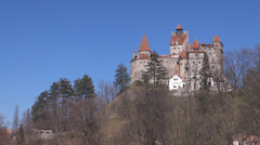Legendary Bran Castle royal iconic view silhouette symbol mountain valley stone  Stock Footage