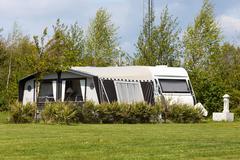 caravan and camping tent - stock photo