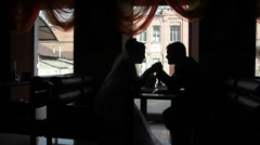 Bride and groom in a cafe Stock Footage