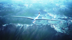 Sailplane over snow capped mountains. Glider flying wings Stock Footage