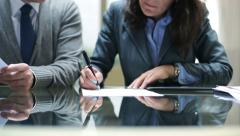 Businesswoman signing documents in the office HD Stock Footage