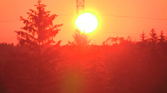 Spectacular fireball red sunset on hot summer evening Stock Footage