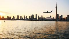 Plane Landing at sunset Stock Footage
