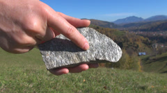 Research hand finger examine explore mineral rock texture study scientific day Stock Footage