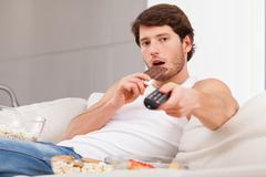 Stock Photo of sweet snacks in front of tv