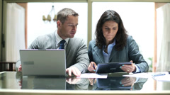 Business people working with tablet and laptop in the office HD - stock footage