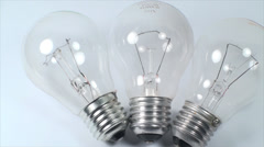 Three Light Bulbs On A White Background, Power, Light, Eco, Friendly, Pan Stock Footage