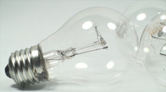 Economic Light Bulbs On A White Background, Power, Light, Eco, Friendly, Pan Stock Footage