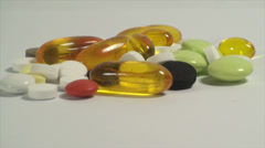 Stock Video Footage of Pills Piled Up On A White Background, Medical, Medicine, Cure, Treatment, Tilt