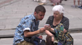 Young man helps senior woman work with smart phone HD Footage