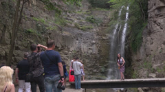 Tourists near exotic waterfall in walking area of the city Tbilisi- Georgia Stock Footage