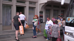 Tourists with bags settling in the hotel - stock footage