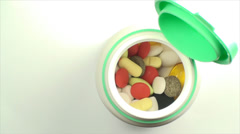 Opened Bottle Of Pills On A White Background, Medical, Medicine, Cure, Treatment Stock Footage