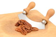Pecan nuts with a rocking knife - stock photo