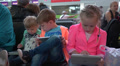 Children playing with laptop in airport Footage