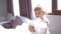 Little beautiful bridesmaid girl in white dress before wedding Stock Footage