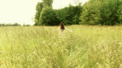 Woman in a field Stock Footage
