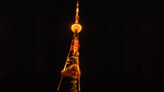 Tbilisi TV tower at night shimmering lights of garlands Stock Footage