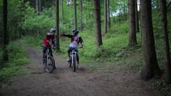 Forest Biking & Friendly Competition Stock Footage