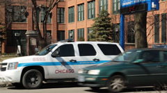 Passing shot of parked Chicago police suv Stock Footage