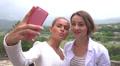 Two beautiful girls making selfie in Georgia landscape Footage