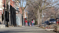 Young african/american children playing on city sidewalk Stock Footage