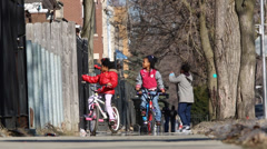 Young african/american children on bikes Stock Footage