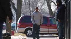 Young african/american man with swagger walks on urban street Stock Footage