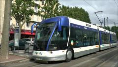 Tram (with audio) pulling into a tram stop in Caen, Lower Normandy, France. Stock Footage