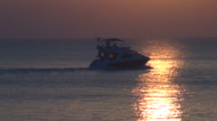 Cruise ship boat pass sunlight sunset sunrise sailing water reflection sea ocean - stock footage