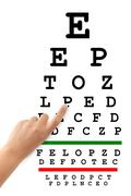 Pointing hand and eyesight test chart Stock Photos