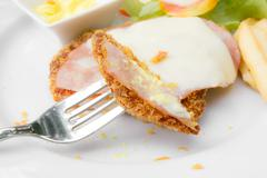Breaded chicken and  french fries Stock Photos