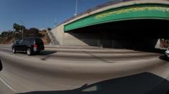 Tracking shot, Black SUV on freeway, fisheye Stock Footage